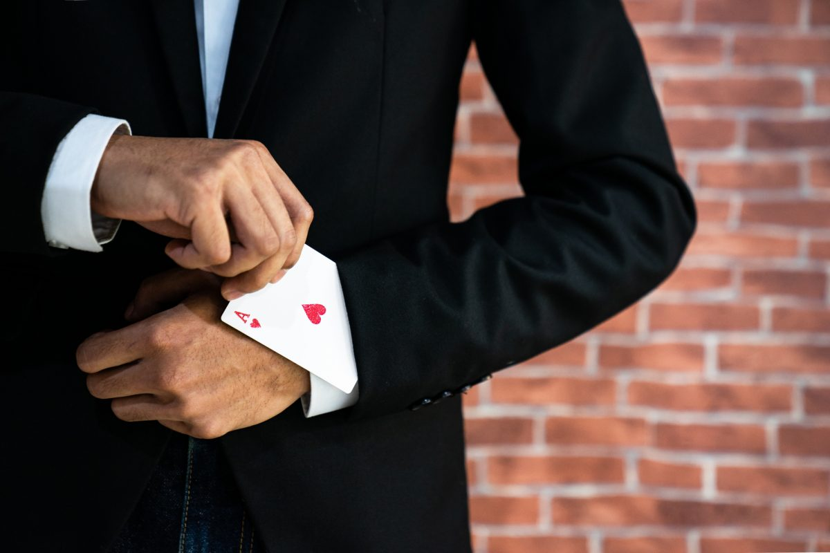 """Abstract image of Business man with ace in his sleeve for """"Open banking poker—Winner takes all"""""""
