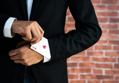 "Abstract image of Business man with ace in his sleeve for ""Open banking poker—Winner takes all"""