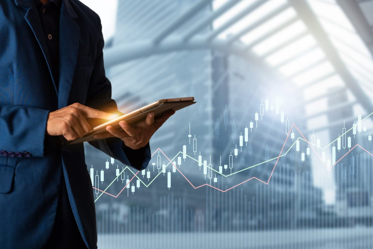 Businessman using tablet with finance and banking profit graph of stock market trade indicator financial