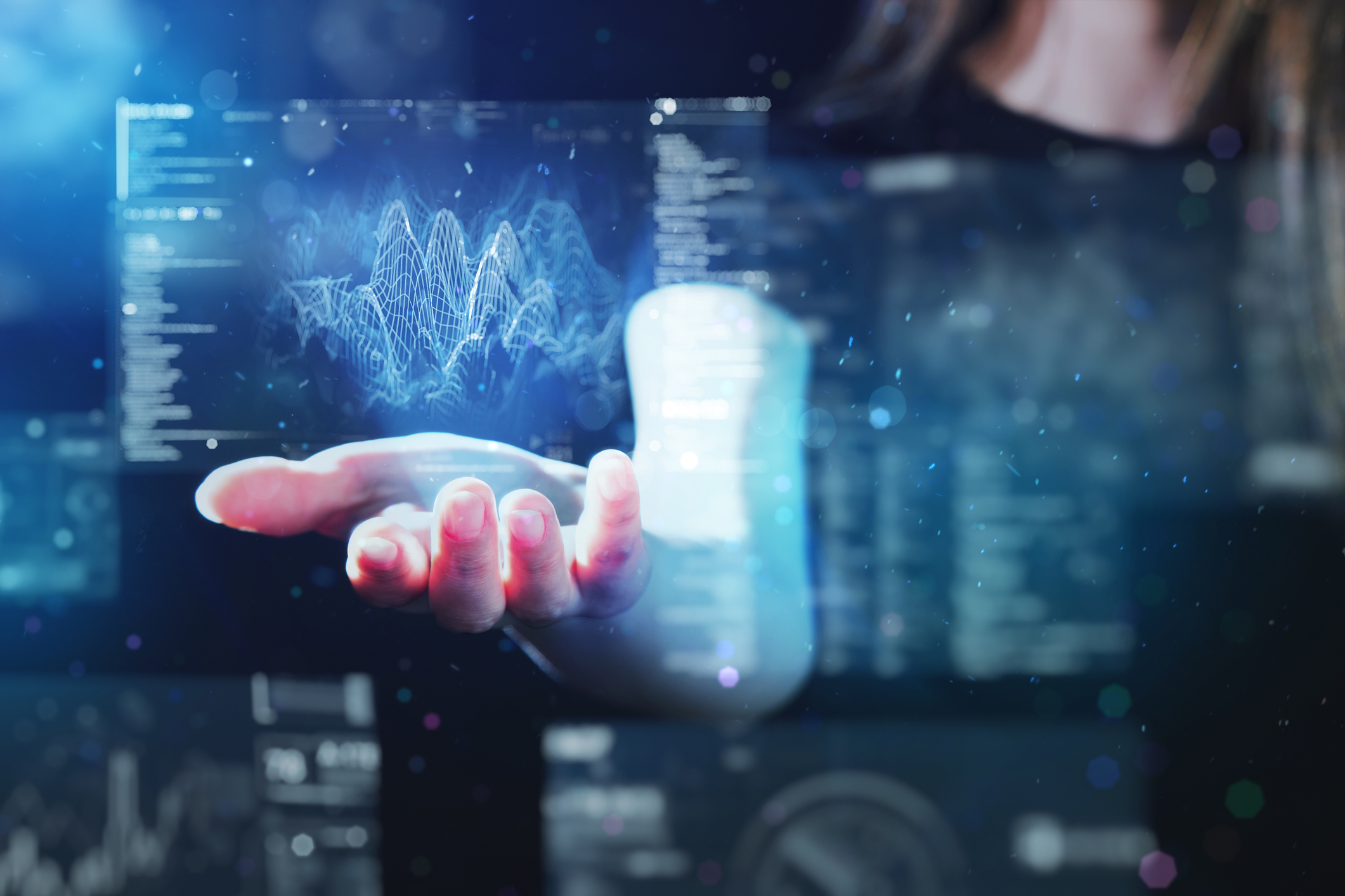 """Woman using futuristic digital interface display as metaphor for the article """"LCR forecasting with AI"""""""