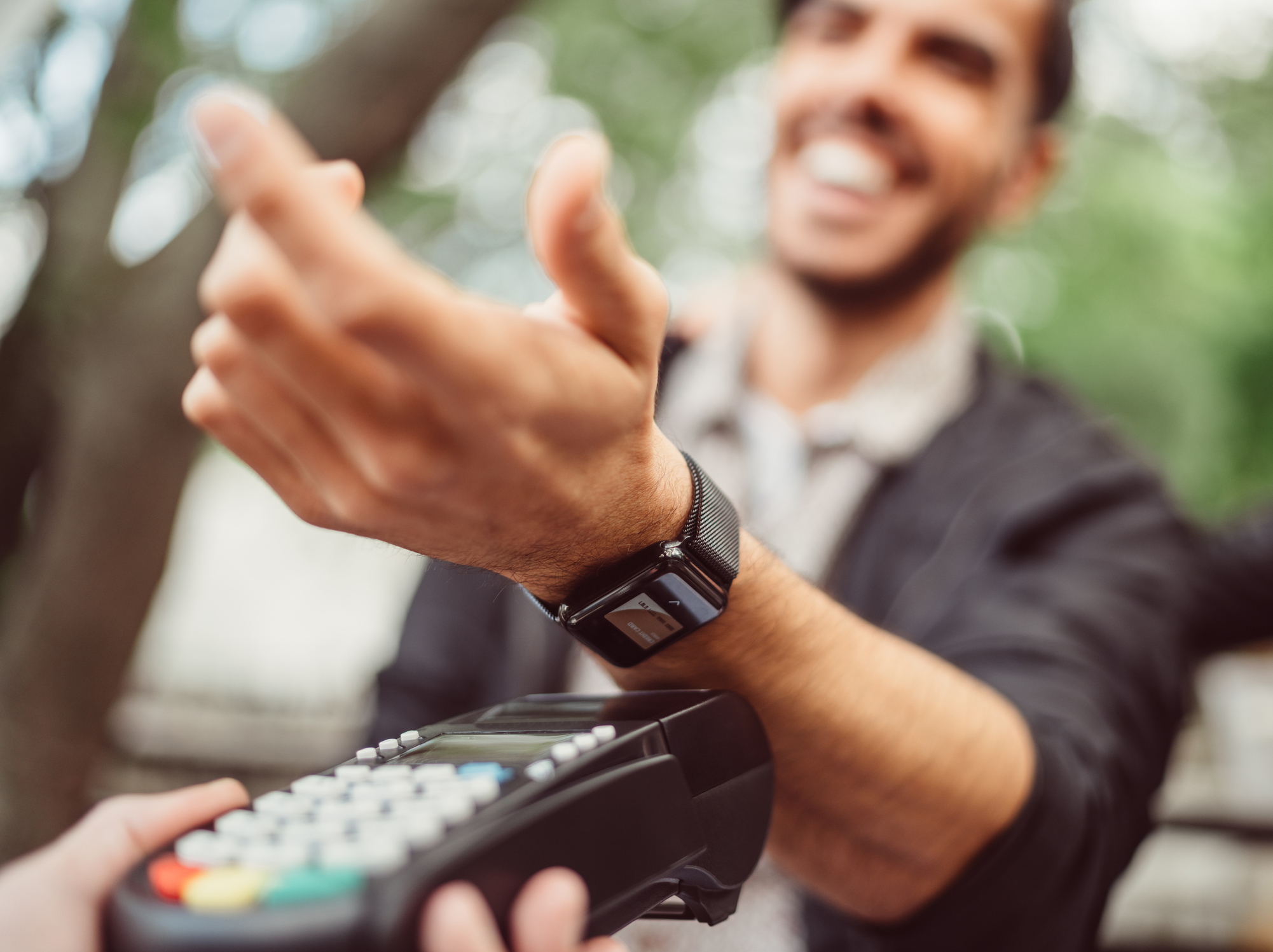 "Man paying contactless as metaphor for ""Future of Payments 2021–trend"