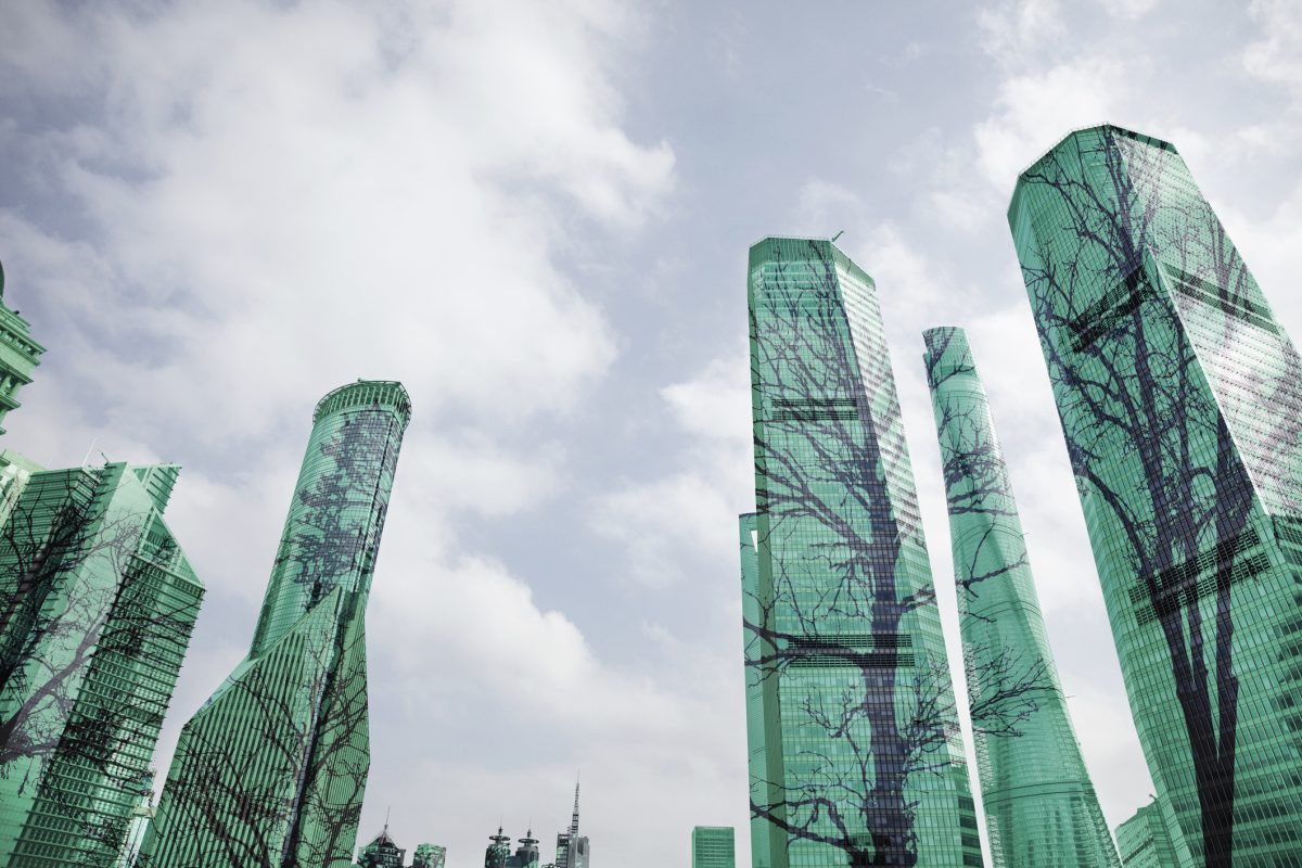 Composite image of trees on buildings in city as metaphor for ESG-investing on the rise