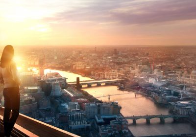 """Young woman looking over the City of London as metaphor for the article """"Banking sector 2021 – promising first half"""""""